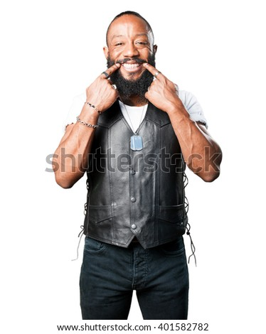 motorcyclist man smiling gesture - stock photo