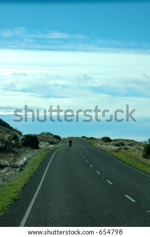 motorcyclist on road - stock photo