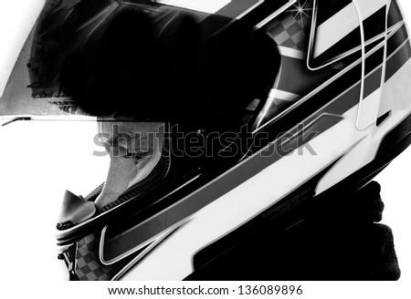 Motorcyclist with helmet in black and white.