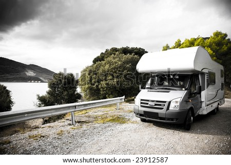 Motorhome Parking On The Gravel Road Near The Lake