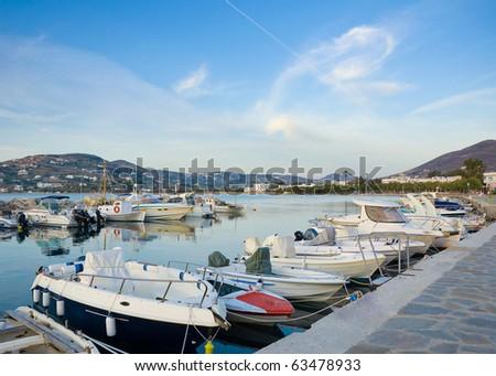 Motorized fishing boats along the pier on the island ... - stock photo