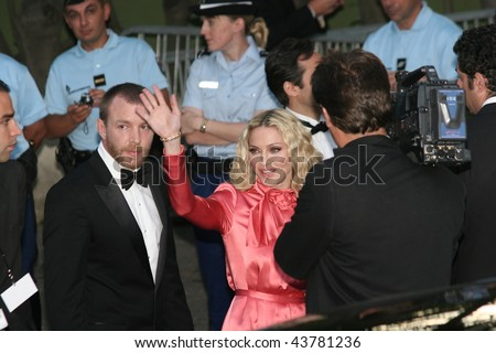 MOUGINS, FRANCE - MAY 22: Madonna arrives at amfAR's Cinema Against AIDS 2008 benefit held at Le Moulin de Mougins during the 61st International Film Festival on May 22, 2008 in Cannes, France. - stock photo