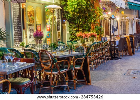 MOUGINS, FRANCE - OCTOBER 31, 2014: Street cafe at night