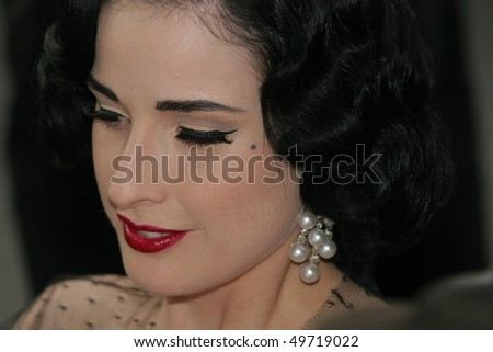 MOUGINS - MAY 23: Dita Von Teese attends the Amfar party against Aids,on the Red Carpet,on May 23 2007 in Mougins France - stock photo