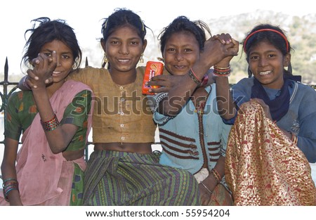 MOUNT ABU, INDIA - NOVEMBER 2: Group of very poor but happy children dressed in rags on November 2, 2007 in Mount Abu, Rajasthan, India - stock photo