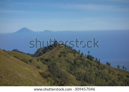 Mount Agung (in Bali) in the background - view from Plawangan Senaru RInjani, Lombok, Indonesia - stock photo