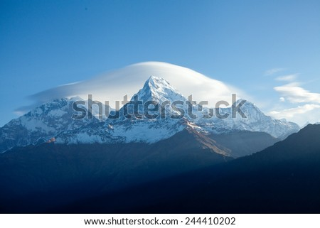 Mount Annapurna South At Sunrise In Himalayas - stock photo