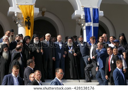 Mount Athos, Greece - May 28, 2016: Russian President Vladimir Putin, (C), President of Greece Prokopis Pavlopoulos, (L), the highest abbot of Mount Athos Pavlos (R) during his visit to Mount Athos. - stock photo