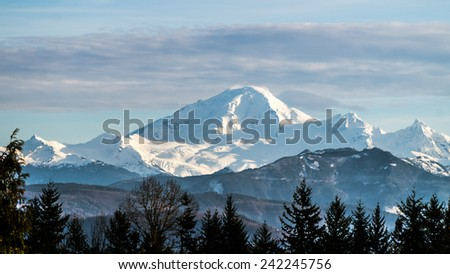 Mount Baker in Washington State seen from the Fraser Valley in British Columbia - stock photo