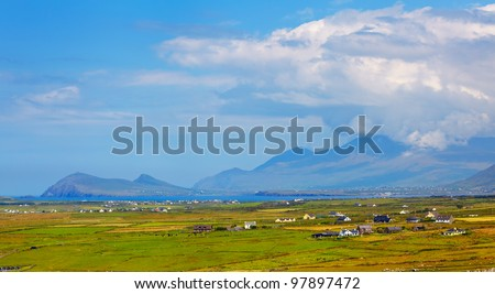 Mount Brandon hidden in the clouds and countryside of Dingle Peninsula, Ireland. - stock photo