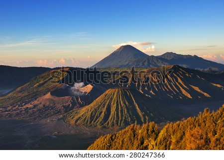 Mount Bromo during sunrise with light and shadow. Mount Bromo is volcanic complex located in Bromo Tengger Semeru National park in East Java, Indonesia   - stock photo