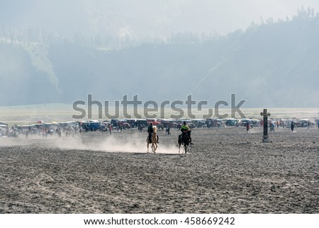 Mount. Bromo, East Java, Indonesia. May 21, 2016. A tenggerese horseman provides horseback riding services for tourists to hike Mount Bromo's crater at Bromo-Tengger-Semeru National Park. - stock photo
