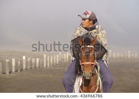 Mount Bromo Indonesia - Jun 13, 2016 : Unidentified Tenggerese man work as horseman waiting for tourist at Mount Bromo one of an active volcano that most visited by tourist in East Java Indonesia. - stock photo
