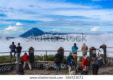 MOUNT BROMO, JAVA-APR 06: Visitors are taking photos of Bromo and Semeru mountain scenery via the highlands Penanjakan. Bromo is popular tourist destination in East Java, Indonesia on 06 April 2014 - stock photo