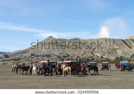 MOUNT BROMO VOLCANO, INDONESIA - SEP 20: A gathering place on sea of sand where horsemen provide horse ride to tourist on Sep 20, 2015 in East Java, Indonesia.  - stock photo