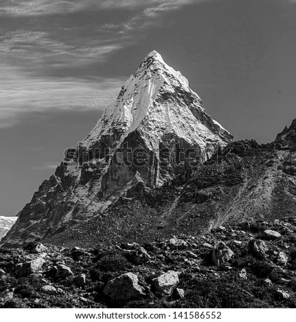 Mount Chola (6069 m) in the area of Cho Oyu - Gokyo region, Nepal, Himalayas (black and white) - stock photo