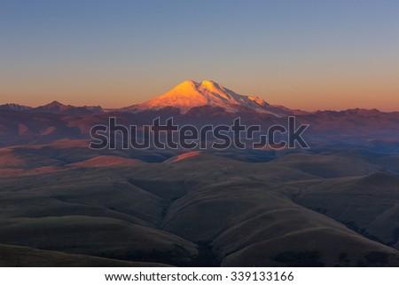 Mount Elbrus in the morning - stock photo