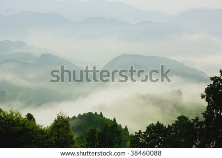 Mount enshrouded in fogs - stock photo