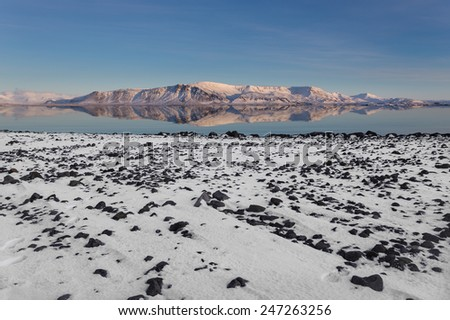 Mount Esja Reflects on Atlantic Ocean in Reykjavik, Iceland - stock photo