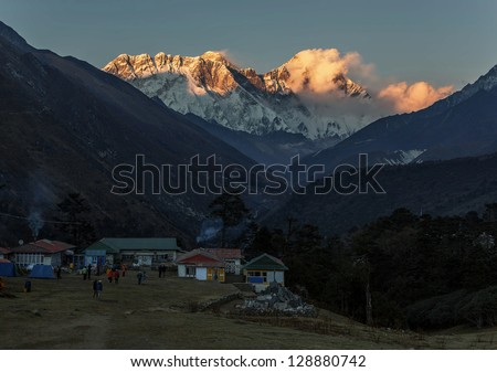 Mount Everest (8848 m) and Lhotse (8511 m) in the last light of the Sun (view from Tengboche monastery) - Nepal, Himalayas - stock photo