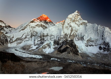 Mount Everest, Nuptse and Khumbu Glacier at sunset, viewed from Kala Pattar in the Nepal Himalaya - stock photo