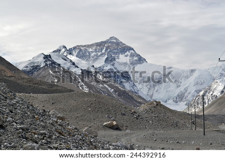 Mount Everest, the tallest mountain in the world and part of the Himalayan Mountain Range, as viewed from the Rongbuk Monastery in Tibet. - stock photo