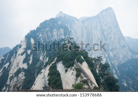 """Mount Hua,located in Shaanxi,is the highest of chinese five sacred mountains, called the """"West Mountain"""",well known for steep trails, breath-taking cliffs, narrow passages, and grand scenery. - stock photo"""