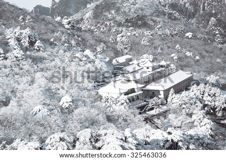 Mount Huangshan winter snow house airview - stock photo