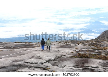 MOUNT KINABALU, SABAH MALAYSIA - JUNE 12, 2016: Unidentified climber descending from mount kinabalu summit via the new summit route