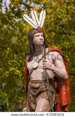 MOUNT KISCO, NEW YORK, USA - OCTOBER 9, 2004: Painted metal statue of native american indian, donated 1907, by resident and temperance leader David Gotham. Statue cast by J. L. Ironworks, NY.