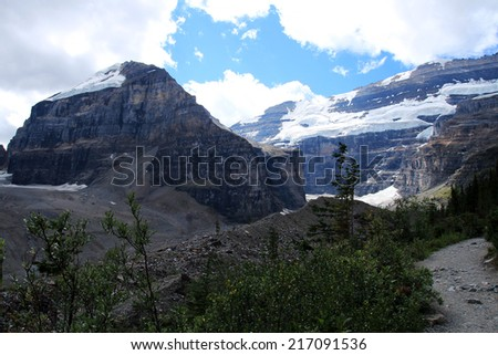 Mount Lefroy and Mount Victoria as seen from the Plain of the Six Glaciers hiking trail near Lake Louise, Banff National Park, Alberta, Canada - stock photo