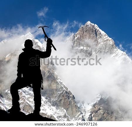 Mount Lhotse and silhouette of man wirh ice axe - trek to everest base camp - Nepal  - stock photo