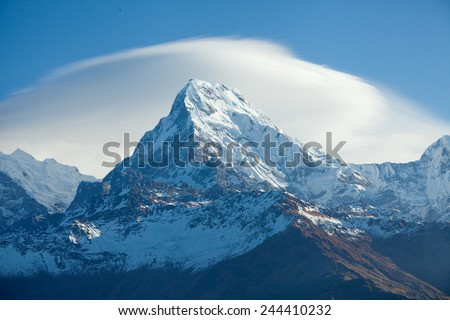 Mount peak Annapurna South At Sunrise In Himalayas - stock photo