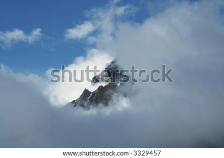 Mount peak in clouds in Himalayan - stock photo