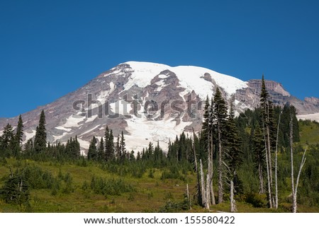 Mount Rainier looks very peaceful and scenic but It is considered to be one of the world's most dangerous volcanoes. - stock photo