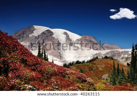 Mount Rainier with valleys covered with brilliant fall colors - stock photo