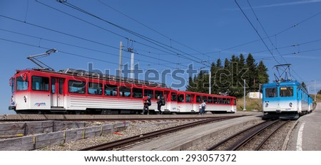 Mount Rigi, Switzerland - 8 September, 2014: Rigi Railways trains on the Rigi Staffel station. Rigi Railways is a group of railways on Mount Rigi, they include two standard gauge rack railways. - stock photo
