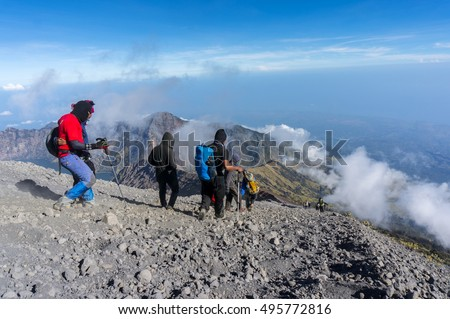 MOUNT RINJANI, LOMBOK, INDONESIA-SEPT 19, 2016 : Unidentified group of mountaineers down hill on their way to the base camp. Rinjani mountain is one of the highest and prettiest mountains in Indonesia