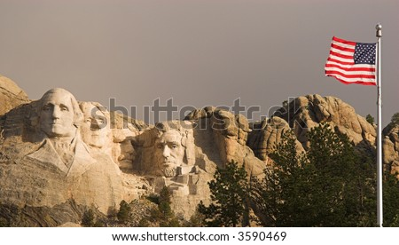 Mount Rushmore and the flag of the United States. - stock photo
