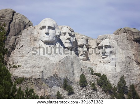 Mount Rushmore National Monument, beneath light clouds.  Vacations in South Dakota - stock photo