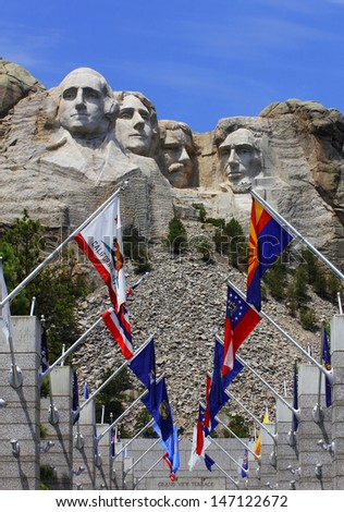 Mount Rushmore National Monument with state flags. South Dakota, USA. - stock photo