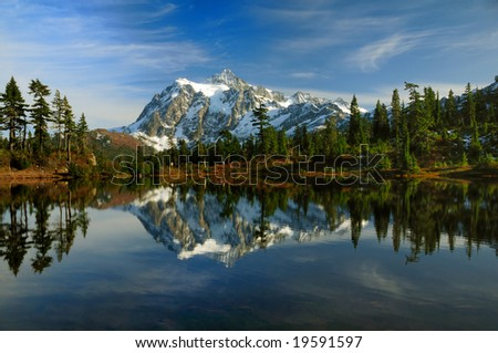 Mount Shuksan reflected across Picture lake during autumn - stock photo