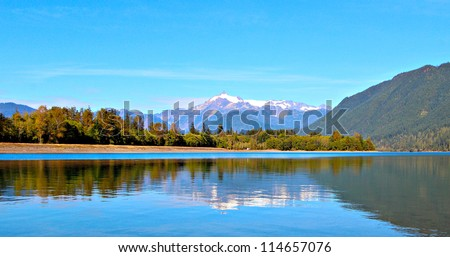 Mount Shuksan reflected in Baker Lake in the  Mt. Baker-Snoqualmie National forest - stock photo