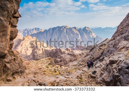 MOUNT SINAI, EGYPT - October 13: Pilgrims and tourists on the pathway from the Mount Sinai peak (Holy Mount Moses) in early morning on October 13, 2014. - stock photo