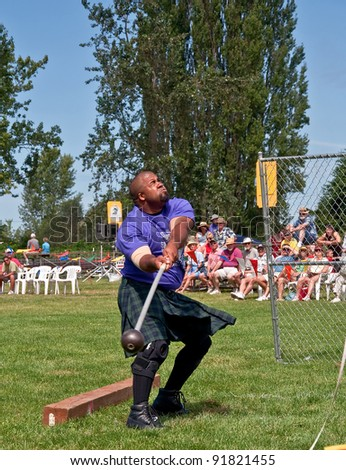 MOUNT VERNON, WA - JULY 9:  Unidentified man at the Scottish Highland games during the hammer toss to bring Scottish culture to the community.   Event was held on July 9, 2010 in Mount Vernon, Wa. - stock photo