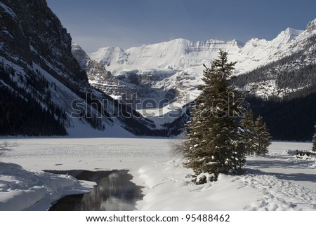 Mount Victoria and a frozen Lake Louise, Banff National Park, Lake Louise, Alberta, Canada - stock photo