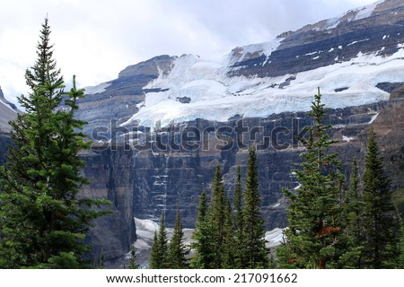 Mount Victoria as seen from the Plain of the Six Glaciers hiking trail near Lake Louise, Banff National Park, Alberta, Canada - stock photo