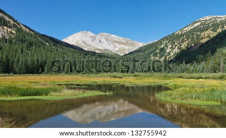 Mount Yale reflecting in a pristine mountain lake in the Collegiate Peaks Wilderness, Colorado, USA - stock photo