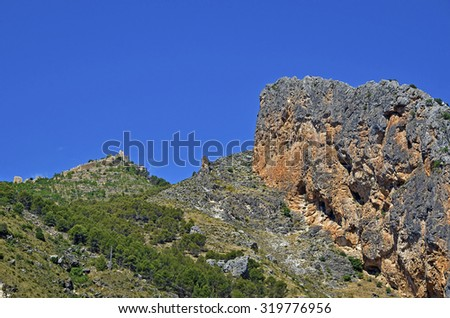 Mountain and castle ruins - stock photo