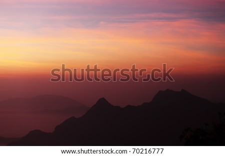 Mountain and Dawn Sky - stock photo